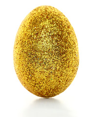 Golden glitter egg isolated on white background