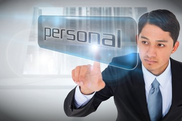 Businessman pointing to word personal