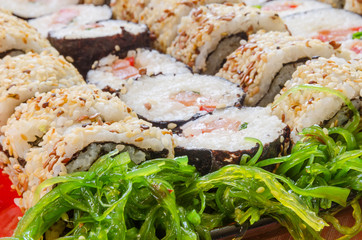 close-up of sushi with seaweed salad
