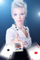 portrait of a young woman throwing poker cards