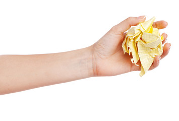 Female hand holding a crumpled paper
