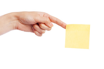 Female hand holding a sticky note