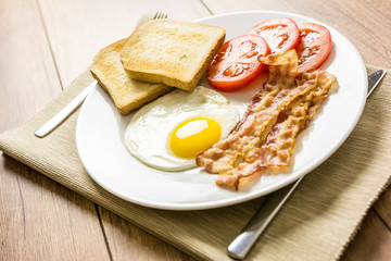 English Breakfast With Fried Egg, Toast, Bacon And Tomatoes