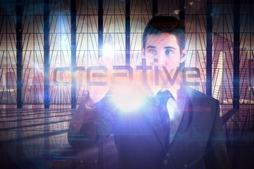 Businessman presenting the word creative