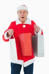 Festive man holding shopping bags