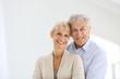 Leinwanddruck Bild - Cheerful senior couple embracing each other