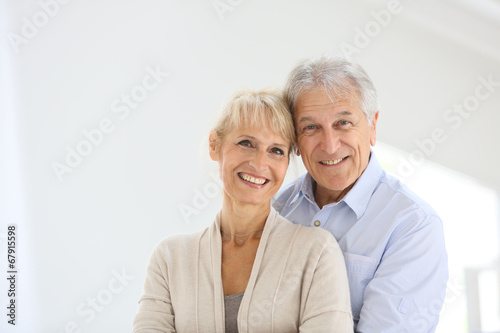 Leinwanddruck Bild Cheerful senior couple embracing each other