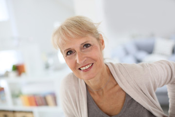 Portrait of smiling blond senior woman