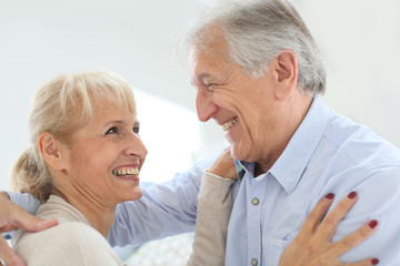 Cheerful senior couple laughing outloud