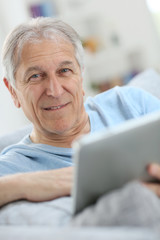 Portrait of senior man using digital tablet