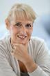 canvas print picture - Portrait of smiling blond senior woman
