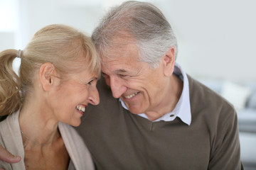 Cheerful senior couple looking at each other's eyes