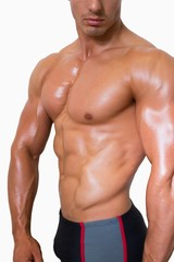 Mid section of shirtless muscular man