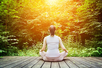 Young woman meditating in a forest. Zen, meditation, breathing