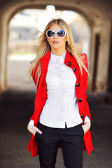 Fashionable young beautiful woman wearing sunglasses