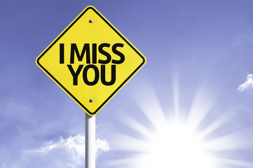 I Miss You road sign with sun background