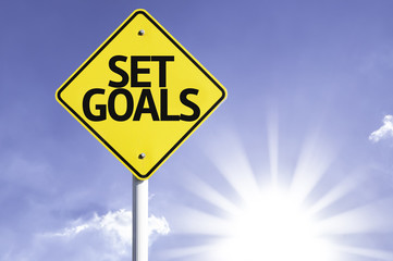 Set Goals road sign with sun background