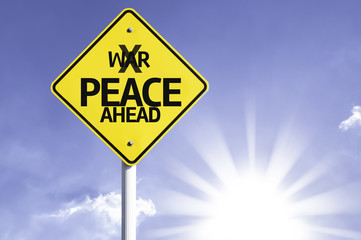 Peace Ahead road sign with sun background