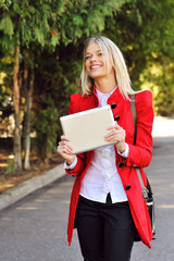 Happy woman holding a tablet computer