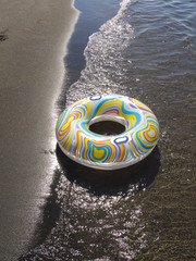 an inflatable donut on the seashore