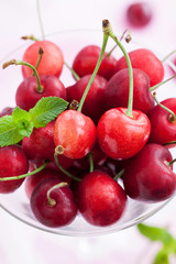 Fresh wet cherry in a glass