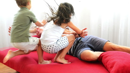 Father playing with kids at home