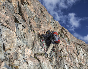 Female hiker climbing with backpack