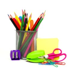 Group of school supplies over a white background
