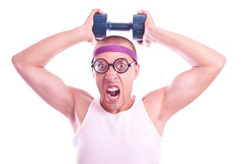 Nerd in glasses with dumbbell trains