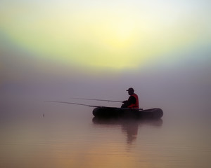 The fishermen on the boat in the fog