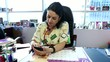 female doctor reading message at mobile phone