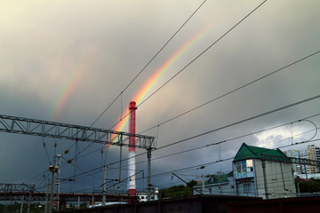 Bright double rainbow above the railway