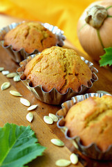 Sweet pumpkin muffins in metal molds .