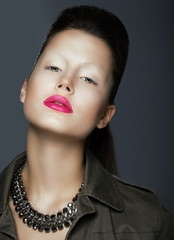 Vogue Style. Sophisticated Woman with Trendy Makeup and Necklace
