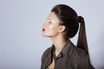 Beauty. Profile of Young Stylish Brunette with Tress