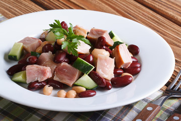 salad with beans, smoked chicken and cucumber