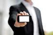 businessman showing black mobile smart phone in hand