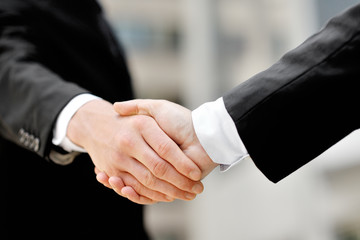businessmen shaking hands - business deal partnership concept
