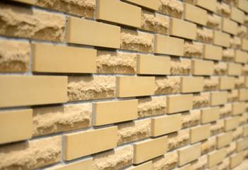 Fence of yellow bricks