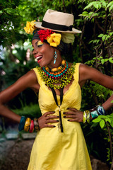 laughing African woman in bright clothes