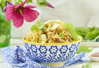 pilaf with chicken, peas and almonds