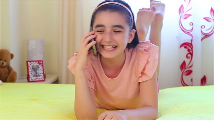 Teenage girl talking on smartphone