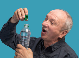 Man holding a bottle of water