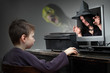 Little boy playing online pc game. Virtual reality concept.