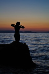 Statue of the mermaid in Podgora in evening