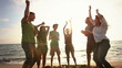 Multiracial Group Dancing at Beach