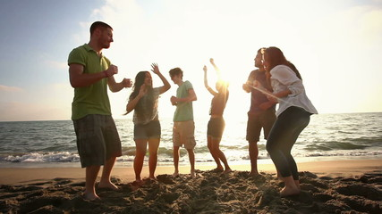 Multiracial Group Dancing at Beach