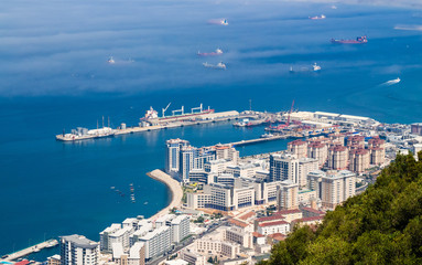 Gibraltar city and harbor with ships.