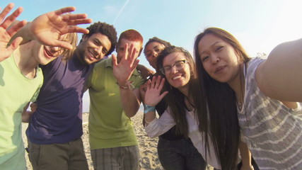 Multiracial Group Having Fun at Beach