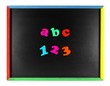 ABC 123 magnetic letters on a blackboard isolated on white